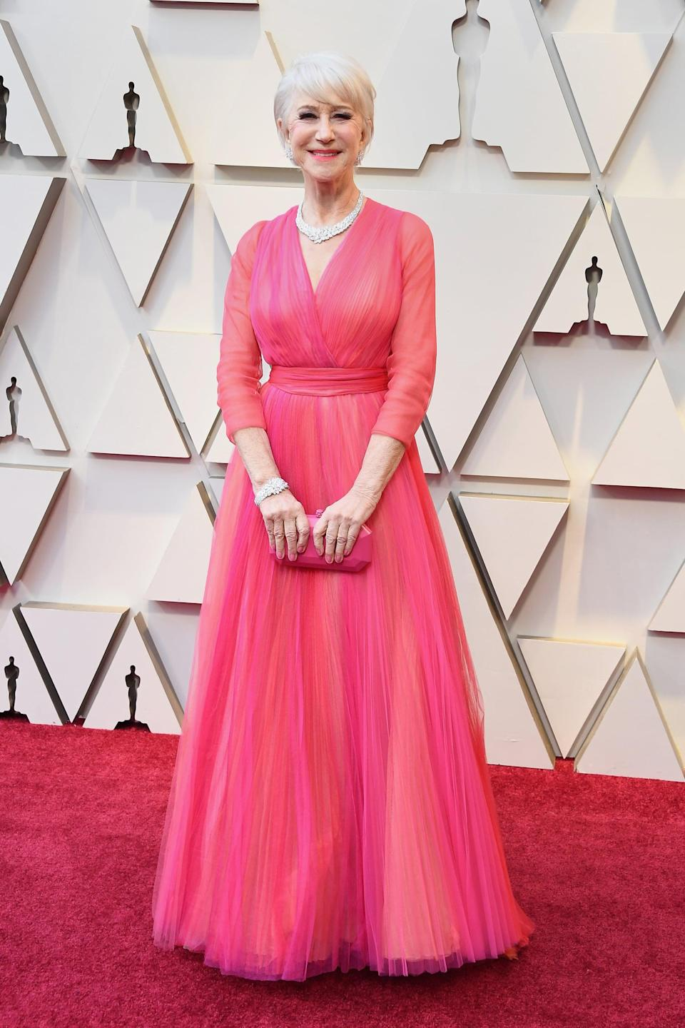 <p>Wearing a Schiaparelli gown with Harry Winston jewels and a Tyler Ellis clutch.</p>