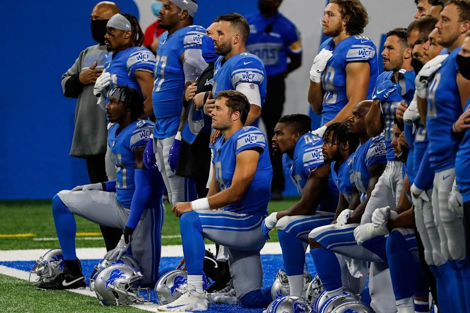 Detroit Lions players include quarterback Matthew Stafford (9) kneel during the playing of national anthem before the game against the New Orleans Saints at Ford Field in Detroit, Sunday, Oct. 4, 2020.