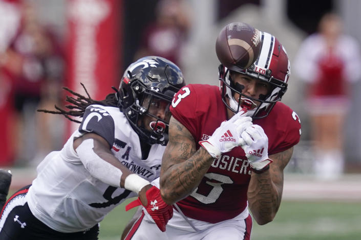 Indiana's Ty Fryfogle (3) tries to make a cat while being defended by Cincinnati's Arquon Bush (9) during the second half of an NCAA college football game, Saturday, Sept. 18, 2021, in Bloomington, Ind. Cincinnati won 38-24. (AP Photo/Darron Cummings)