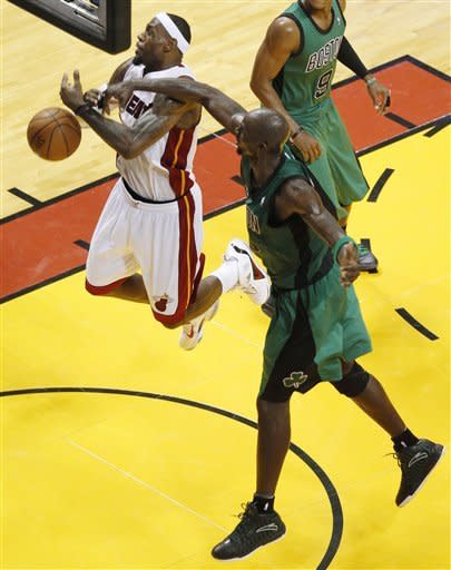Boston Celtics' Kevin Garnett, right, knocks the ball from Miami Heat's LeBron James, left, during the second half of Game 1 in their NBA basketball Eastern Conference Finals playoff series, Monday, May 28, 2012, in Miami. The Heat defeated the Celtics 93-79. (AP Photo/Wilfredo Lee)