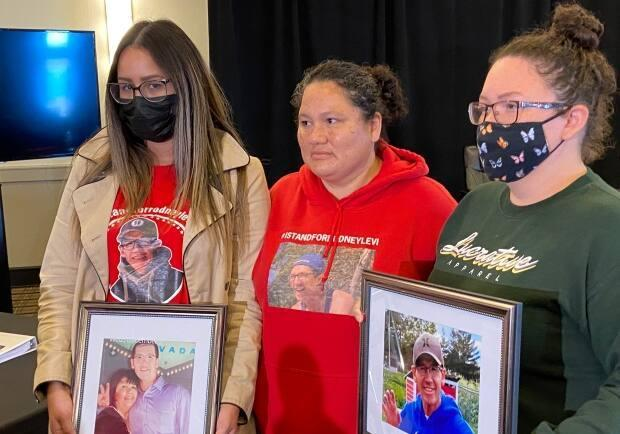 The family of Rodney Levi said they were pleased with the jurors selected for the coroner's inquest into his death. Pictured are his niece, Gina Levi, left, his sister, Rhoda Levi, middle, and his niece, Mimiges Danny, right. (Rachel Cave/CBC - image credit)