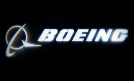 "The Boeing Company logo is projected on a wall at the ""What's Next?"" conference in Chicago"