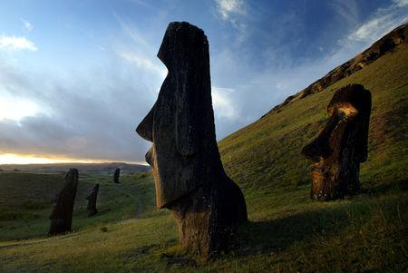 "FILE PHOTO: A view of ""Moai"" statues in Rano Raraku volcano, on Easter Island, 4,000 km (2486 miles) west of Santiago, in this photo taken Oct. 31, 2003. Easter Island's mysterious ""Moai"", giant head statues carved out of volcanic rock, are in danger of being destroyed by years of tropical rains and wind as well as careless humans and farm animals. Experts have called on the international community to commit funds to preserve the monoliths, whose mystery draws tourists to the world's most remote inhabited island. RIGHTS  FREE REUTERS/Carlos Barria"