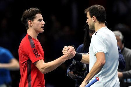 Tennis - ATP World Tour Finals - The O2 Arena, London, Britain - November 13, 2017 Bulgaria's Grigor Dimitrov (R) shakes the hand of Austria's Dominic Thiem after their group stage match Action Images via Reuters/Tony O'Brien