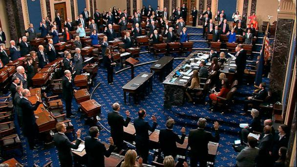 PHOTO: In this image from video, presiding officer Supreme Court Chief Justice John Roberts swears in members of the Senate for the impeachment trial against President Donald Trump at the Capitol, Jan. 16, 2020. (Senate Television via AP)