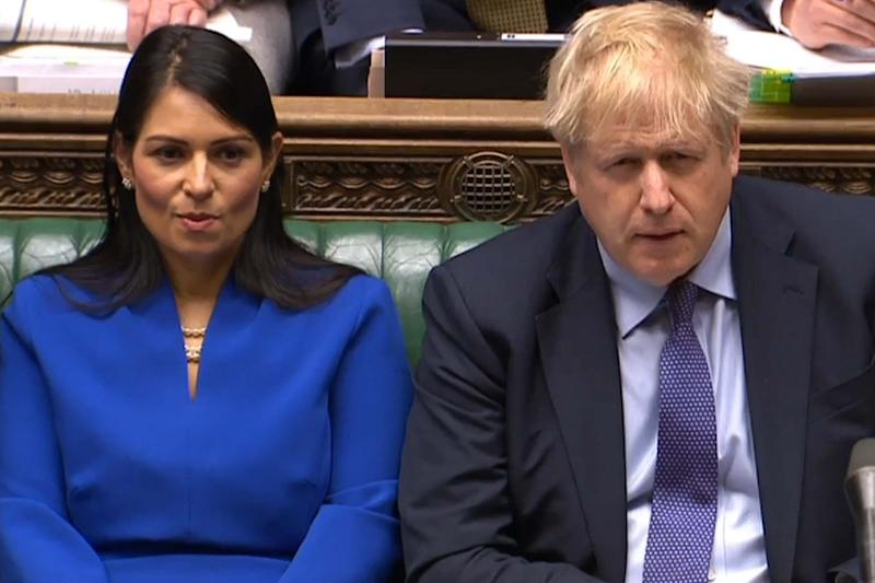 "Sir Philip said he had ""encouraged"" the Home Secretary, pictured with Boris Johnson, to ""change her behaviours"" (PRU/AFP via Getty Images)"