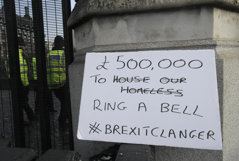 A banner placed by anti Brexit campaigners outside Parliament in London, Wednesday, Jan. 15, 2020. The Big Ben bell of Britain's Parliament has been largely silent since 2017 while its iconic clock tower undergoes four-years of renovation. Brexit-backing lawmakers are campaigning for it to strike at the moment Britain leaves the European Union at 11 p.m. (2300GMT) on Jan. 31, but some campaigners and officials say it is not worth the cost, which has been estimated at around 500,000 pounds (dollars 650,000 US). ( (AP Photo/Kirsty Wigglesworth)