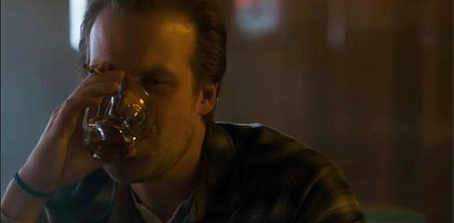 "<p><strong>On Sheriff Hopper's drinking and smoking habits:</strong> ""I drink… I think it's tea. Unsweet tea. We don't drink real alcohol. I don't drink in life anyway. I smoke real cigarettes. When I'm with the kids, I smoke herbals. [But] I do like to be a smoker when I play a smoker, because it's one of those things: When you see someone fake-smoking in a scene, and you can tell they don't smoke in real life, that annoys me a lot.""<br><a href=""https://www.yahoo.com/tv/emmys-stranger-things-star-david-harbour-revisits-sheriff-hoppers-tough-guy-moment-140042348.html"" data-ylk=""slk:Watch the full video interview.;outcm:mb_qualified_link;_E:mb_qualified_link"" class=""link rapid-noclick-resp newsroom-embed-article"">Watch the full video interview.</a><br><br>(Credit: Netflix) </p>"