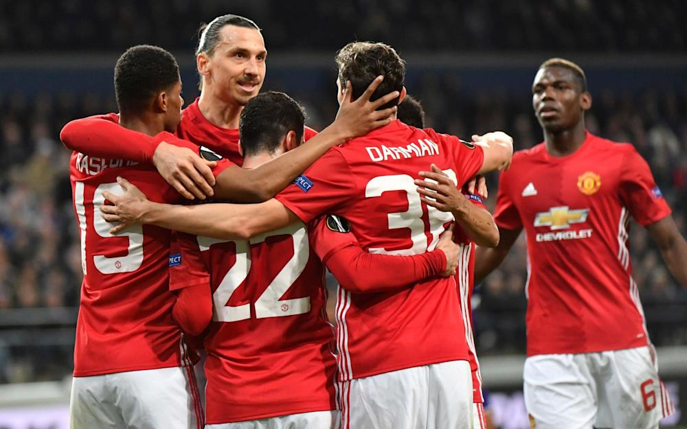 United's players celebrate after Henrikh Mkhitaryan, 3rd left, scored the opening goal  - Credit: AP Photo/Geert Vanden Wijngaert