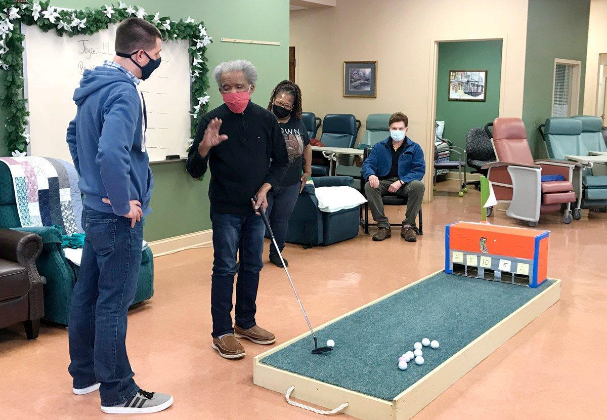 A group of people play games at a non-profit senior daycare center at a church.