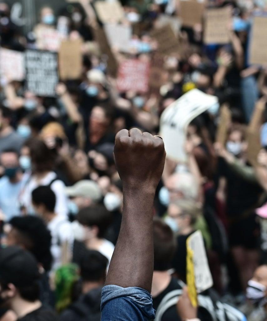 """TOPSHOT – Protesters demonstrate on June 2, 2020, during a """"Black Lives Matter"""" protest in New York City. – Anti-racism protests have put several US cities under curfew to suppress rioting, following the death of George Floyd while in police custody. (Photo by Johannes EISELE / AFP) (Photo by JOHANNES EISELE/AFP via Getty Images)"""