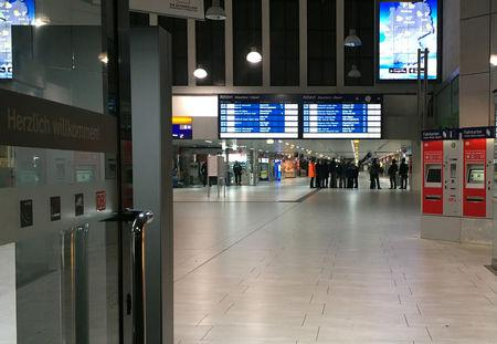 Staff members are pictured inside Dusseldorf train station