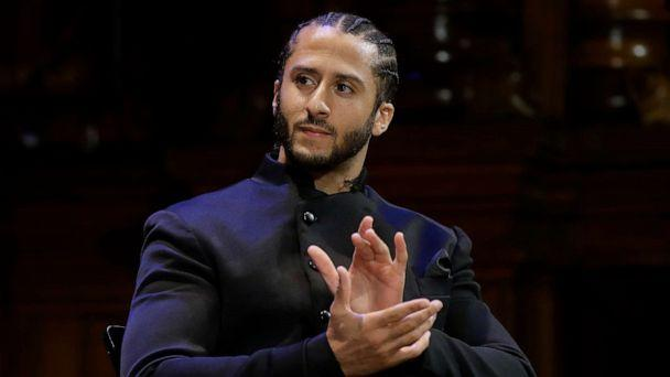 PHOTO: Former NFL football quarterback Colin Kaepernick applauds while seated on stage during W.E.B. Du Bois Medal ceremonies, Oct. 11, 2018, at Harvard University, in Cambridge, Mass. (Steven Senne/AP, FILE)