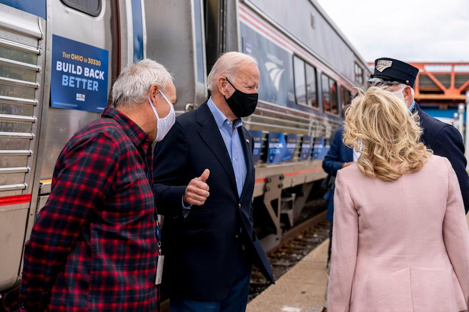 Then Democratic presidential nominee Joe Biden gives a thumbs up after speaking to supporters before boarding his train with his wife Jill Biden, right, at Amtrak's Cleveland Lakefront train station on Sept. 30, 2020.