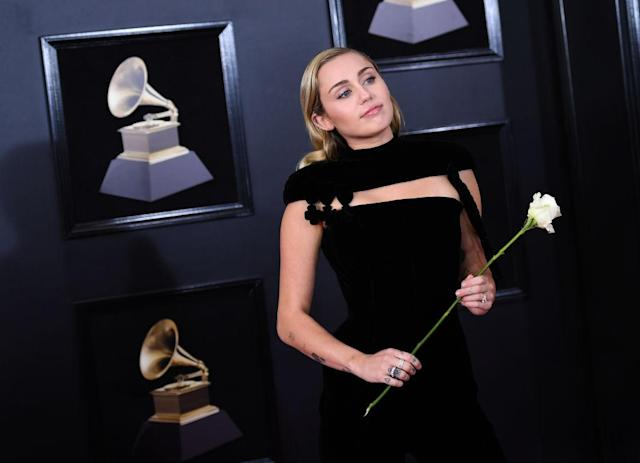Miley Cyrus on the Grammys red carpet. (Photo: Getty Images)