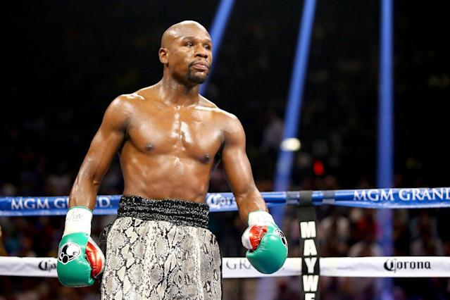 Floyd Mayweather Jr. during the WBC/WBA welterweight title fight at the MGM Grand Garden Arena on September 13, 2014 in Las Vegas, Nevada (AFP Photo/Al Bello)