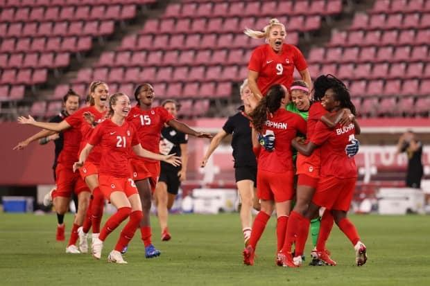 Team Canada celebrates its victory over the United States Monday in the semifinals of the women's soccer tournament at the Tokyo Olympic Games.  (Atsushi Tomura/Getty Images - image credit)