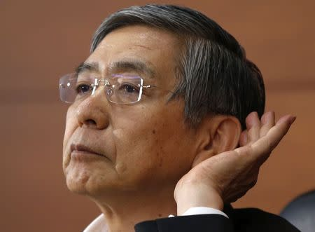 BOJ Governor Kuroda listens to question during news conference at BOJ headquarters in Tokyo