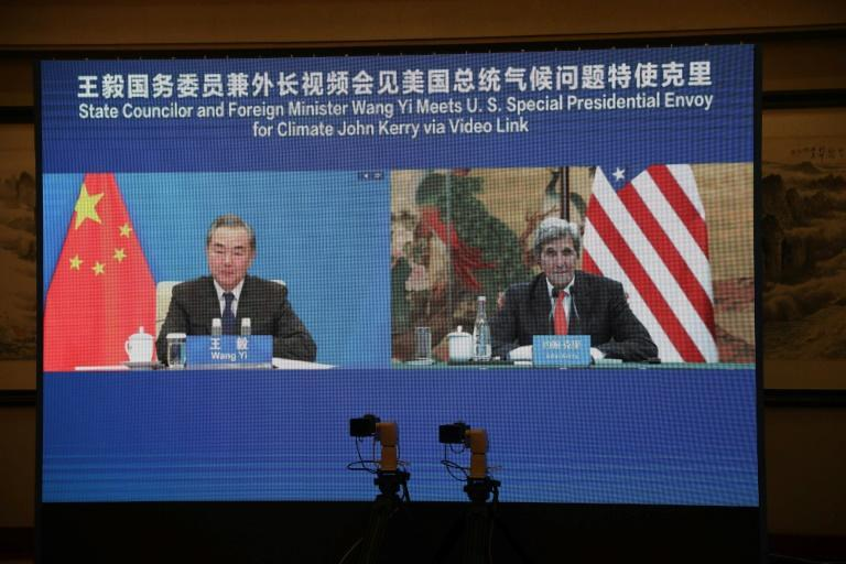 US climate envoy John Kerry meets with China's Foreign Minister Wang Yi via a video link during Kerry's visit in Tianjin in September 2021 (AFP/Handout)