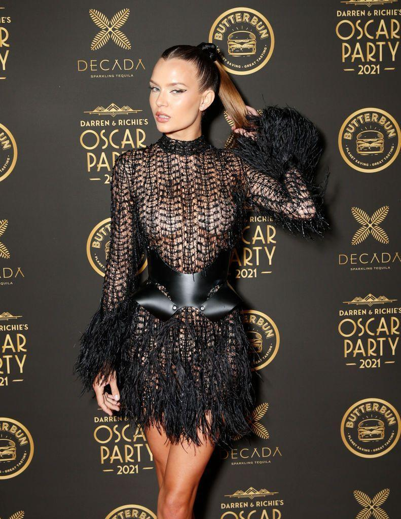 <p>The model attended an Oscars after party held by nightlife businessmen Darren Dzienciol and Richie Akiva wearing a Julien MacDonald feathered mini dress.</p>