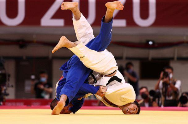 PHOTO: Lukhumi Chkhvimiani of Georgia is seen in action against Naohisa Takato of Japan on july 24, 2021 in the quarterfinals of Judo. (Sergio Perez/Reuters)