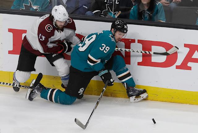 FILE - In this May 8, 2019, file photo, San Jose Sharks center Logan Couture (39) reaches for the puck in front of Colorado Avalanche center Alexander Kerfoot (13) during the first period of Game 7 of an NHL hockey second-round playoff series in San Jose, Calif. The Sharks wasted little time replacing Joe Pavelski as captain, giving the role to Couture even before starting training camp. (AP Photo/Jeff Chiu, File)