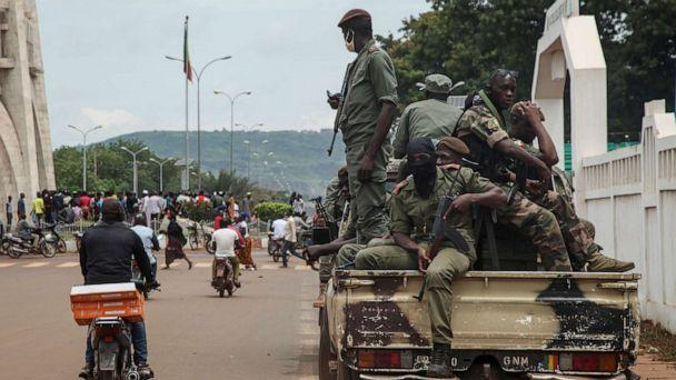 PHOTO: Security forces ride in a truck in the capital Bamako, Mali, Aug. 19, 2020. (Baba Ahmed/AP)