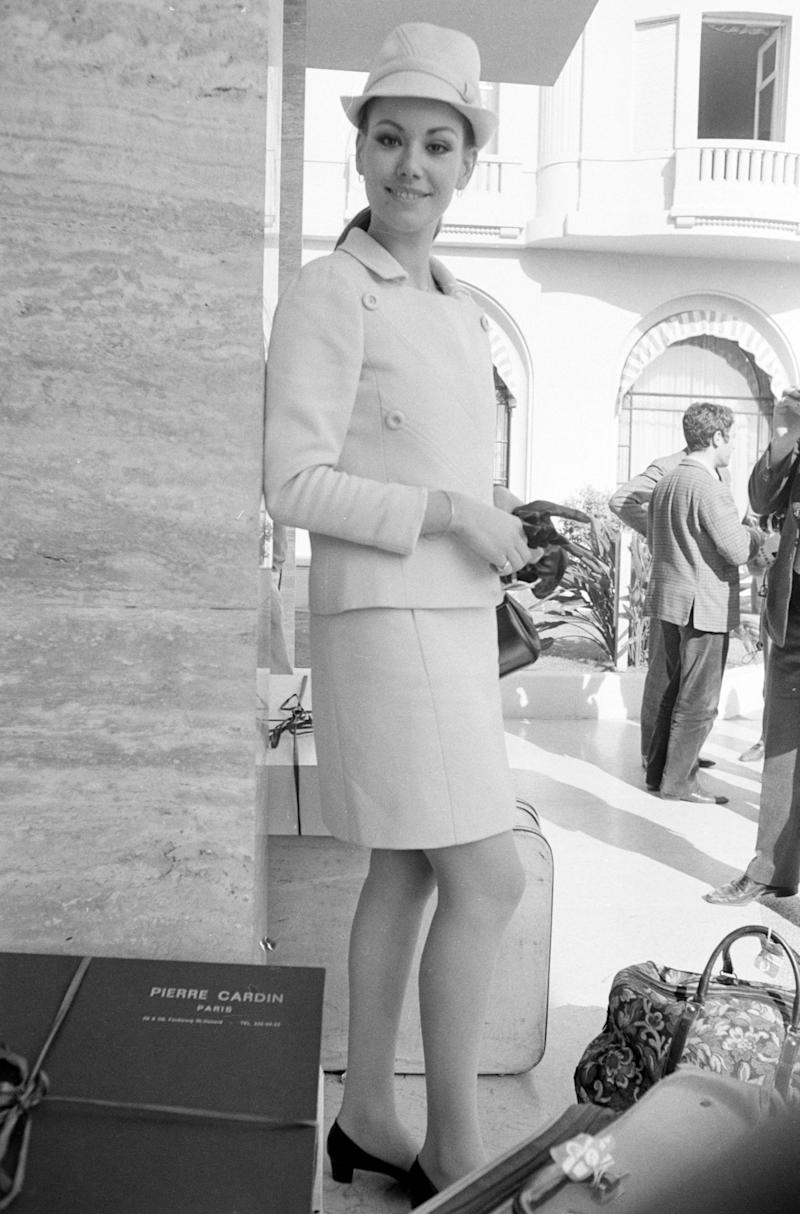 Claudine Auger with travel gear