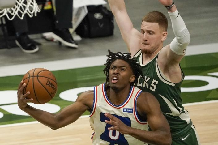 Philadelphia 76ers' Tyrese Maxey drives past Milwaukee Bucks' Donte DiVincenzo during the first half of an NBA basketball game Saturday, April 24, 2021, in Milwaukee. (AP Photo/Morry Gash)
