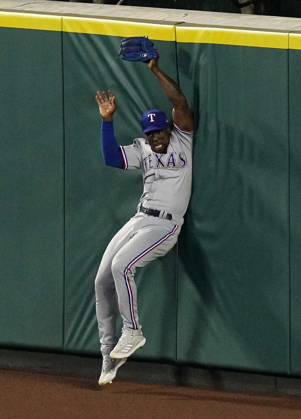 Texas Rangers right fielder Adolis Garcia hits the wall as he makes a catch on a ball hit by Los Angeles Angels' Shohei Ohtani during the fourth inning of a baseball game Monday, April 19, 2021, in Anaheim, Calif. (AP Photo/Mark J. Terrill)