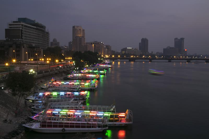In this Saturday, Sept. 28, 2013 photo, boats are parked waiting for customers on the Nile river, Egypt. Boat rides for many Egyptians are part of the nightlife culture. The Nile is Egypt's primary source of water and most of the population live along its banks as it runs through the country north to south from the border with Sudan to the Mediterranean Sea. (AP Photo/Hassan Ammar)