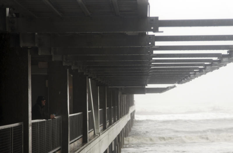 Ray Bartling, a facilities manager for the Pier Shops at Ceaser's, looks over the rough surf in Atlantic City, N.J., Monday, Oct. 29, 2012. (AP Photo/Seth Wenig)