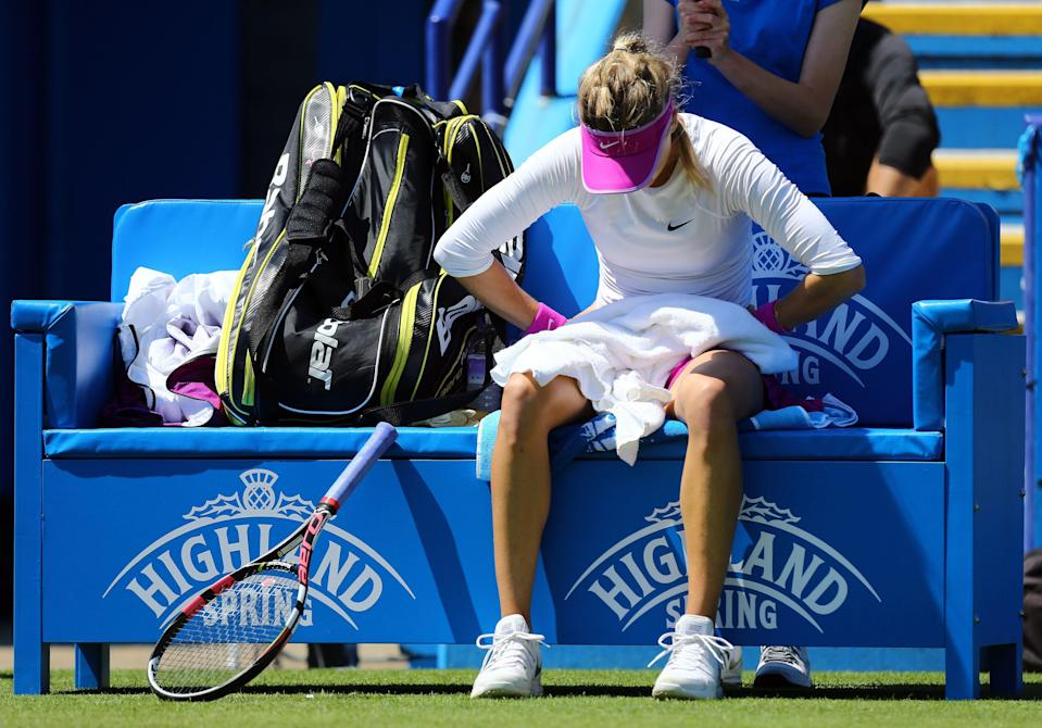 Canada's Eugenie Bouchard takes a break before retiring in her match against Switzerland's Belinda Bencic during day five of the women's international tennis tournament at Devonshire Park, Eastbourne, England, Wednesday June 24, 2015. (Gareth Fuller/PA via AP) UNITED KINGDOM OUT NO SALES NO ARCHIVE