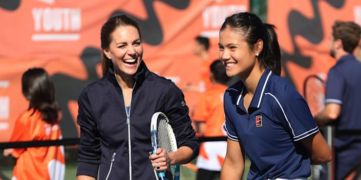 Kate Middleton talks to British US Open champion Emma Raducanu as they return to the LTA's National Tennis Centre for The Homecoming and to celebrate their success on September 24, 2021 in London, England.