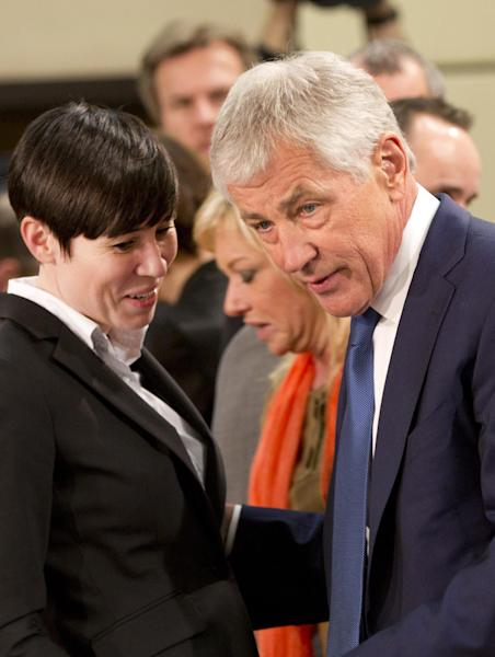 U.S. Secretary of Defense Chuck Hagel, right, speaks with Norwegian Defense Minister Ine Marie Eriksen Soreide during a meeting of defense ministers of the North Atlantic Council at NATO headquarters in Brussels on Wednesday, Feb. 26, 2014. Frustrated with his Afghan counterpart, U.S. President Barack Obama is ordering the Pentagon to accelerate planning for a full U.S. troop withdrawal from Afghanistan by the end of this year. But Obama is also holding out hope that Afghanistan's next president may eventually sign a stalled security agreement that could prevent the U.S. from having to take that step. (AP Photo/Virginia Mayo)
