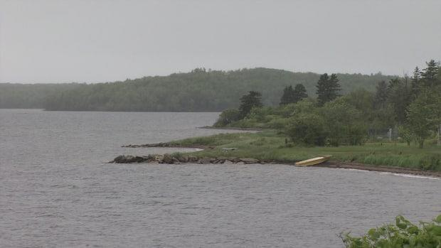Two people were using a jet ski on Bras d'Or Lake when it overturned Saturday. One individual made it to shore, but the other did not. (Gary Mansfield/CBC - image credit)