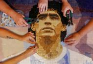 FILE PHOTO: Maradona's fans remember the idol with a colorful memorial in Buenos Aires