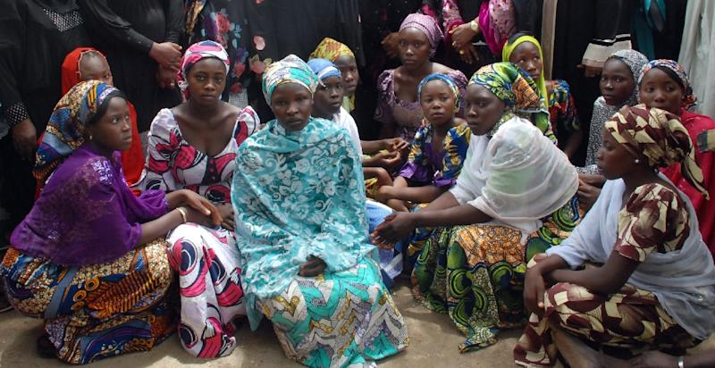 Picture taken on May 5, 2014 shows Chibok school girls who escaped from the Boko Haram Islamists gathering to receive information from officials (AFP Photo/)