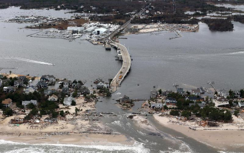 This aerial photo made from a helicopter shows storm damage from Sandy over the Atlantic Coast in Mantoloking, N.J., Wednesday, Oct. 31, 2012. The photo was made from a helicopter behind the helicopter carrying President Obama and New Jersey Gov. Chris Christie, as they viewed storm damage from superstorm Sandy. (AP Photo/Doug Mills, Pool)