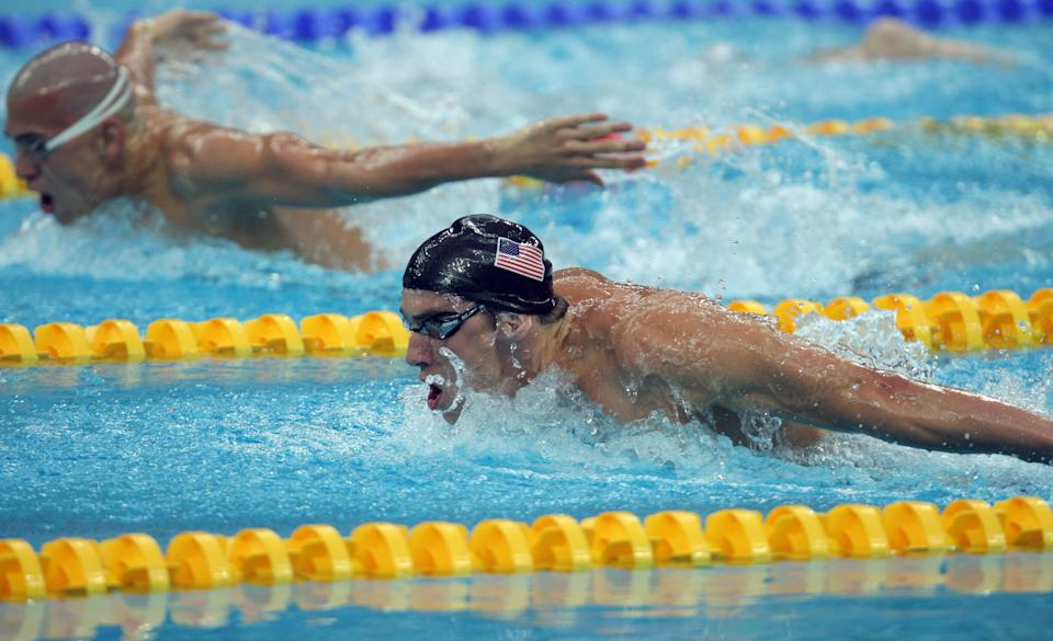 Swimming the butterfly, Michael Phelps takes the gold in the 400 individual medley setting a new world record, at the 2008 Olympic Games, Sunday Aug. 10, 2008 in Beijing, China. (Photo By Michael Macor/The San Francisco Chronicle via Getty Images)