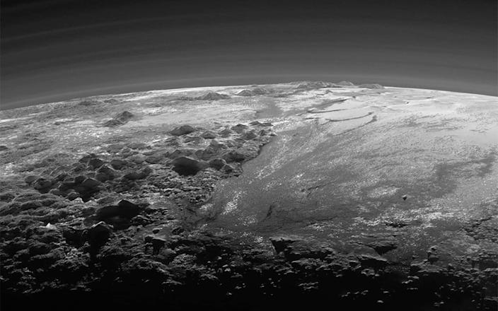 A close-up view of the rugged, icy mountains and flat ice plains on Pluto is seen in an image from NASA's New Horizons spacecraft - NASA /REUTERS