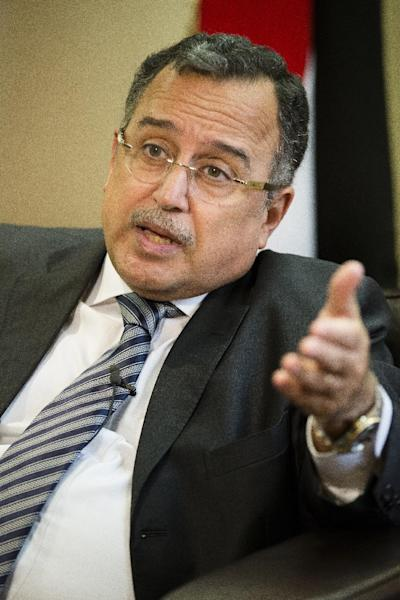 Egyptian Foreign Minister Nabil Fahmy answers questions while being interviewed at the Egyptian Mission during the 68th session of the United Nations General Assembly, Wednesday, Sept. 25, 2013, in New York. (AP Photo/John Minchillo)