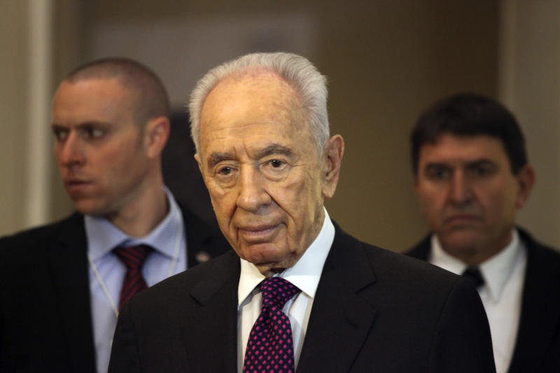 Israeli President, Shimon Peres, arrives to give a brief statement at the World Economic Forum, in Southern Shuneh, 34 miles (55 kilometers) southeast of Amman, Jordan, Sunday, May 26, 2013. Peres says it is possible for Israelis and Palestinians to overcome differences and skepticism over peacemaking and that it is time to restart serious negotiations and conclude a peace treaty that has long dogged the two warring sides. AP Photo/Mohammad Hannon)