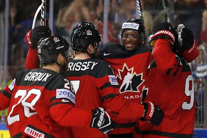Canada's players celebrate a goal during the IIHF Men's World Championship Ice Hockey semi-final match against Russia in Cologne on May 20, 2017 (AFP Photo/Ina FASSBENDER)