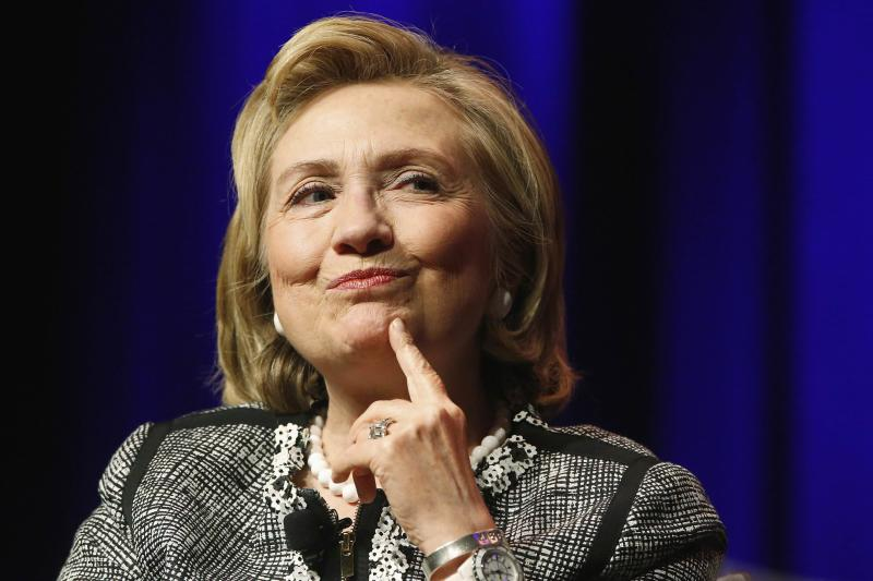 """Clinton reacts to a question as she discusses her new book """"Hard Choices"""" at George Washington University in Washington"""