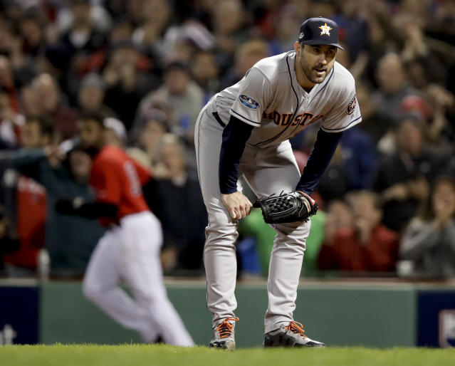 Houston Astros starting pitcher Justin Verlander reacts after Boston Red Sox's Jackie Bradley Jr. scored on a wild pitch during the fifth inning in Game 1 of a baseball American League Championship Series on Saturday, Oct. 13, 2018, in Boston. (AP Photo/Charles Krupa)