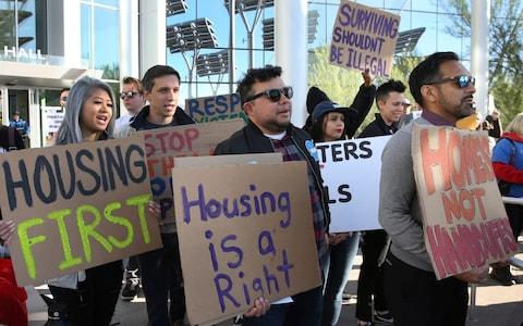 Protesters outside Las Vegas City Hall say housing shortages should be tackled before making 'surviving illegal' for the homeless - Credit: Bizuayehu Tesfaye/Las Vegas Review-Journal