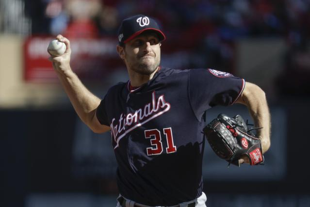 Washington Nationals starting pitcher Max Scherzer throws during the first inning of Game 2 of the baseball National League Championship Series against the St. Louis Cardinals Saturday, Oct. 12, 2019, in St. Louis. (AP Photo/Mark Humphrey)