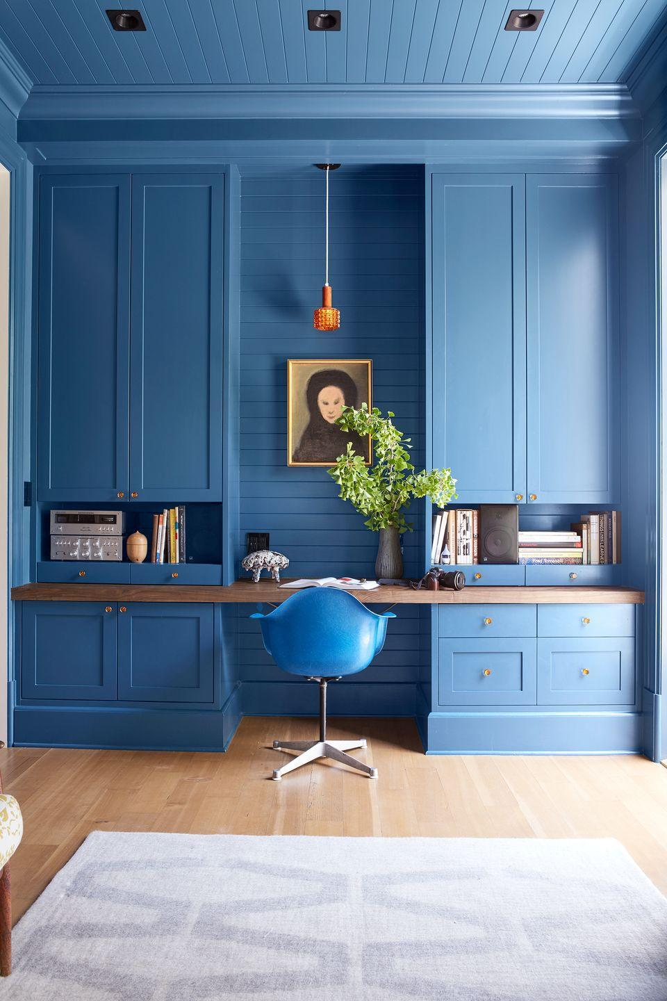 <p>Make your home office feel comforting and inspiring to you, whatever that may mean. Here, that meant sticking to a blue color scheme. If you have a favorite color, why not run with it? A bold paint color introduces your personality without taking up any useable floor space, too. </p>