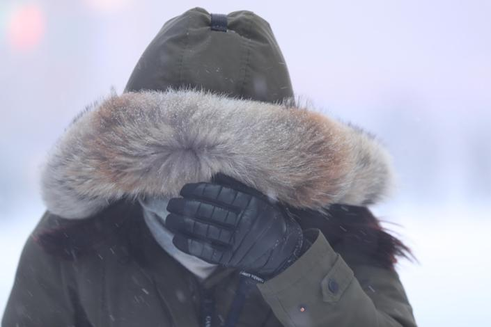 <p>A woman covers her face against the hard wind and snow in Times Square in New York City during a winter snowstorm on Thursday, Jan. 4, 2018. (Photo: Gordon Donovan/Yahoo News) </p>